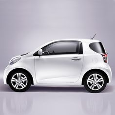 iQ by Toyota...YES I WOULD DRIVE THIS IN TOWN WITH GAS AS HIGH AS IT IS