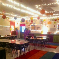 Classroom decorating ideas. I like lots of lights and lamps in my classroom rather than always using those harsh florescent lights. Also it is good to have the extra light when using the promethean board so I can see the students and they have enough light to be able to work. I use gem clips to hang Christmas lights around the ceiling and also put them around bulletin boards. Lamps are placed throughout the room. It's cozy and the kids love it.
