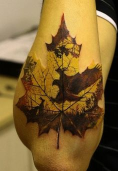 Leaf tattoo with forest scene, Canadian Maple Leaf
