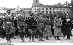 Nazi leaders Heydrich (2nd from left) and Himmler (4th from left) attend the funeral of the Italian chief of police on November 21, 1940.
