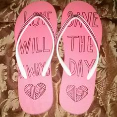 Aero flip flops Cute pink flip flops that say Love Will Always Save The Day. Size med Aeropostale Shoes