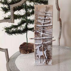 Gift box, stick tree and spray snow.