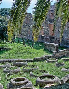 Large terracotta jars in the Caseggiato dei Doli area of the ancient Roman port city of Ostia Italy