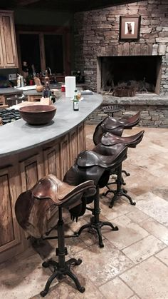 Vintage used saddles for bar stools! #Equestrian In the barn lounge!