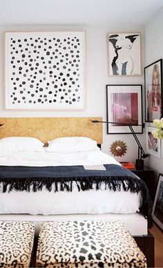 bedroom with black and white textiles and colorful framed art / sfgirlbybay