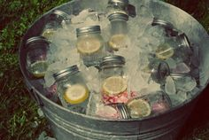 Pre-made drinks in individual Mason jars, in galvanized tub.