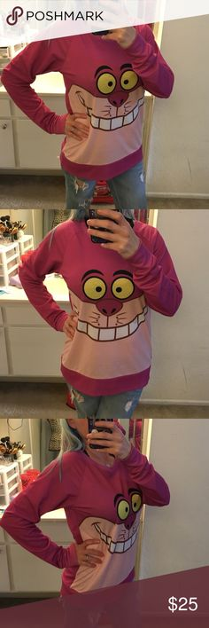 NWOT CHESHIRE CAT SWEATSHIRT Super cute new without tags size medium purchased at Hot Topic made by Disney Disney Sweaters Crew & Scoop Necks