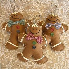 Stuffed Felt Gingerbread Men Christmas Ornaments--These would be easy to make.  So cute!