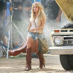 Star Tracks: Tuesday, August 4, 2015 | THESE BOOTS ARE MADE FOR WALKING | Dressed in knee-high fringe boots and denim cut-off shorts, new mom Carrie Underwood braves the California heat on Sunday on the set of her latest music video.
