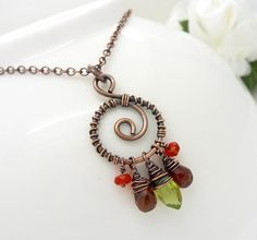 peridot and garnet copper wire wrapped gemstone necklace with mexican fire opal by CreativityJewellery