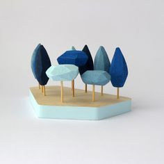 Miniature tabletop forest in shades of blue.Small winter garden .Trees hand painted with acrylic with pentagonal wood base on Etsy, 25,98 €