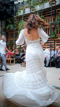 Plus size boho wedding gown with long sleeves from Studio Levana