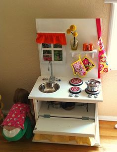 Play kitchen from an old nightstand...  looks pretty doable.  Something to think about in a couple of years for the new niece!