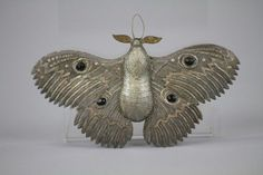 """Dresden moth ornament. Germany, this hard to find, large Dresden moth has  silver coloring on the top and gold on the bottom  with two gold and silver antenna and great detail throughout. 5-1/2"""" wing. (US $1,200)"""