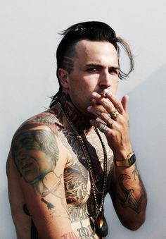 Yelawolf mullet mohawk with Johnny Cash tatted on the side ...