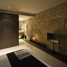 stone wall with modern interiors