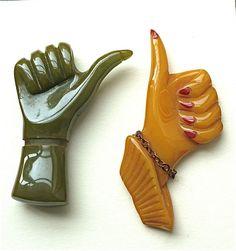 Bakelite thumbs-up brooches