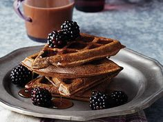 Buckwheat Belgian Waffles | The buckwheat flour adds an earthy, nutty flavor to these waffles, but it's also a flour that's heavy and dense. Here, it's blended with lighter tapioca flour and white rice flour to balance it. Beating the egg whites and folding them into the batter is also key to keeping the texture light. Top the waffles with slightly warm maple syrup and fresh fruit. They're so dreamy you could serve them for breakfast or dessert.