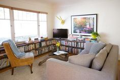 Alexis & Brooks' Charming West Hollywood Apartment Featuring wrap around cinder block shelves that don't suck!