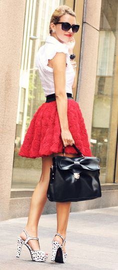 Pinup Fashion: this is such a cute look! white sleeveless top, black belt, red skirt, black bag with a bow and white with black polka dots heels. Love it!