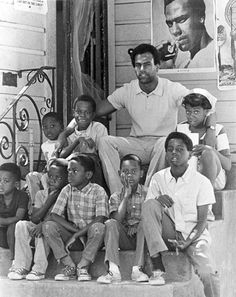 Huey Newton out of prison and surrounded by youth of  East Oakland community, August 1970. Photograph by Ducho.