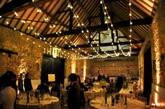 Festoon lighting canopy as an alternative to fairy lights, Monks' Barn Hurley. Wedding lighting by Oakwood Events Ltd.