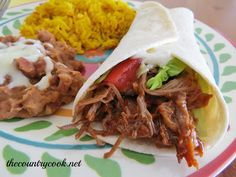 The Country Cook: Crock Pot Shredded Beef Tacos.  Rub the meat with the taco seasoning.   Sear the meet in a pan with olive oil just to brown both sides and then out into crock pot.