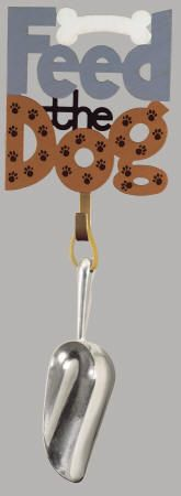 Happy Tails Dog Plaque with Food Scoop. What better way to keep track of the dog food scoop than this decorative wall plaque. This plaque is made of metal and has a hook on the back for hanging on the wall. Something any dog fancier will enjoy. Measures 5.75 by 14.5 inches. $10.20