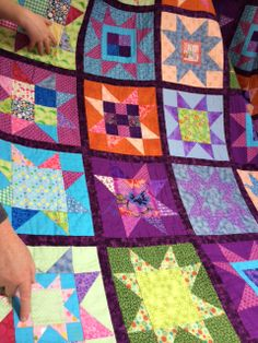 Everyone's pointing to their favourite Sawtooth Star block on Sophie's quilt!