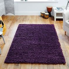 elsa shaggy rugs are power loomed in egypt by oriental weavers with a pile this soft plum shaggy rug benefits from being stain resistant
