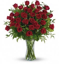 One, two, three! Three dozen spectacularly gorgeous red roses delivered in a dazzling flared glass vase - positive proof that love is a many-splendored thing. Imagine her loving this amazing bouquet day after day. Hero-worshipping time.    This impressive bouquet includes 36 red roses accented with assorted greenery. Delivered in a flared glass vase.