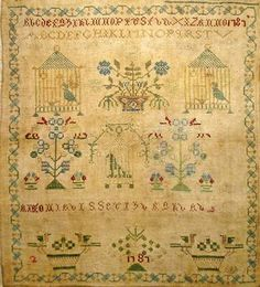 I love the bird cages on this sampler.  (Bird cages make me happy...birds in cages make me sad.)
