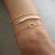 Delicate gold stacking bracelet set, with fine gold chain and freshwater pearls