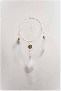Dreamcatcher made with grouse feathers from the north of Norway, quartz, pearl and brass. www.malinpettersen.com My Arts, Quartz, Grouse, Brass, Pearls, Dream Catchers, Norway, Feathers, Home Decor