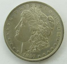 Lot 51a in the 11.19.13 online & live auction! 1887-O Morgan Silver Dollar. 26.73g of 90% Silver when minted. 11,550,000 minted. Graded by the consignor as MS65 with Proof Like Finish, toning. Designed by George T. Morgan. No Sales Tax on Coins, Currency, or Bullion. #Money #Coin #Antique #POGAuctions