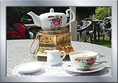 Ostfriesland tea 'ceremony': a lump of crystallised sugar, an artistically floated cloud of cream from a decoratedflat silver spoon and the all-important 'stövchen': a little copper 'stove' to keep the teapot warm.