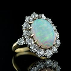 My forever-favorite gemstone - Opal (also my birthstone).  I would have put this on my Wishlist board, but it's $7950, lol!