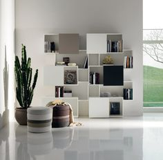 Cattelan Piquant library  The library Piquant from original and modern design, is ideal to complement the decor of the living area or the living room. The sliding doors, make this dynamic library and functional.  http://www.industryinterior.com/en/prod/living-room/library/cattelan-piquant-library.html
