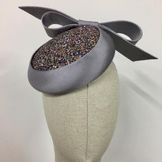Grey silk shantung beret percher with insert panel of sparkling paillettes from UK milliner Dillon Wallwork.