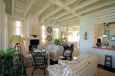 old beach cottage styled living room with khaki buffalo checks