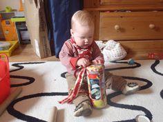Threading ribbon through a money box Money Box, Baby Play, Infant Activities, Threading, Home Appliances, Entertaining, Ribbon, Babies, House Appliances