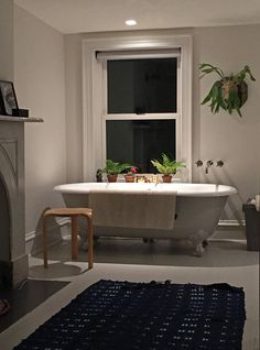 Baths Recessed lights over the tub.