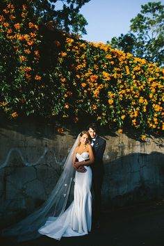 No more romantic backdrop than an endless wall of flowers // Photography: Kait Photography