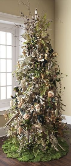 Nature inspired Christmas tree. Elves are kinda creepy but the tree is gorgeous!