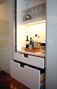 Kansas City Homes Gardens - kitchens - frosted glass, frosted glass cabinets, glass cabinetry, white cabinetry, sliding cabinet doors, flo...
