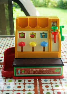 I had one of these, my Sister and I played Store with, we both loved putting the plastic coins in there slots and turning the green handle and watching the cash draw open. One of the best childhood memories!