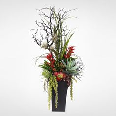 Bring a colorful and quirky look to your foyer with this silk floral arrangement. Housed in a metal container, the arrangement includes several types of plants and flowers that create a striking visua                                                                                                                                                                                 More