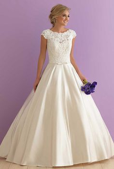 Brides: Allure Romance. Fit for royalty, this cap sleeved ballgown pairs gorgeous lace with shimmering satin.