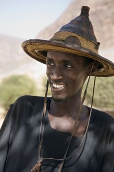 Africa | A Fulani man wearing a traditional hat. The Fulani are predominantly pastoral people scattered over many parts of West Africa. Mopti, Mali | © John Warburton-Lee