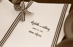 Simple black and white ribbon can be used fon invitations and ceremony booklets